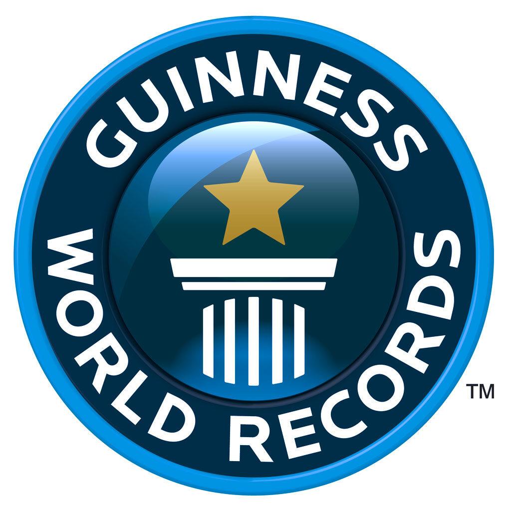 Logo circolare con capitello sormontato da una stella dorata e intorno la scritta Guinness World Records