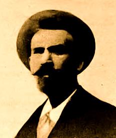 Fotografia primo piano di Oronzo Gargiulo. Uomo con baffi e cappello
